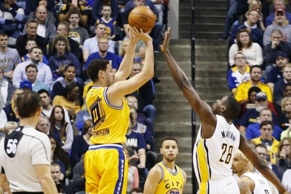 Dec 8, 2015; Indianapolis, IN, USA; Golden State Warriors guard Klay Thompson (11) takes a shot against Indiana Pacers center Ian Mahinmi (28) at Bankers Life Fieldhouse. Mandatory Credit: Brian Spurlock-USA TODAY Sports