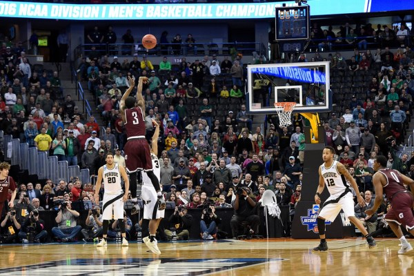 Josh Hagins (3) of the Arkansas Little Rock Trojans hits a three-pointer to tie the game against Purdue Boilermakers to force overtime during the second half of Little Rock's 85-83 double-overtime win in the first round NCAA Tournament on Thursday, March 17, 2016. (Photo by AAron Ontiveroz/The Denver Post)